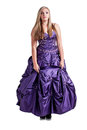 Princess pout a pretty caucasian girl wearing a full purple ball gown making a funny and raising her eye brows Stock Photography