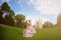 Princess in an vintage dress before the magic castle a woman like a Royalty Free Stock Photo