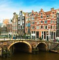 Prinsengracht Canal and typical Dutch houses behind the bridge in winter, Amsterdam, The Netherlands Royalty Free Stock Photo