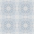Seamless abstract light blue mandala pattern, floral background.