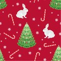 Christmas green tree, white bunny, Christmas candies and snowflakes on  red background seamless pattern. Royalty Free Stock Photo