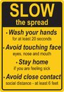 Slow Tarffic Sign Designed to Remind People to Slow the Spread of a Virus