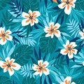 Hawaiian seamless pattern with pink flowers and blue tropical leaves. Stylish floral endless print for summer fabric design. Royalty Free Stock Photo