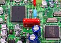 Printed circuit Board with chips and radio components electronics Royalty Free Stock Photo