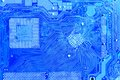 Printed circuit board detail of blue with silver studs Stock Photography