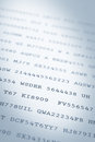 Printed codes close up of random of numbers and letters on paper narrow dof Stock Photo