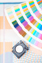 Printing concept pantone palette with loupe and printed material Royalty Free Stock Image