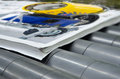 Printing plant magazine line binding process convayer belt after offset print extreme closeup of the conveying of a full automatic Royalty Free Stock Photo