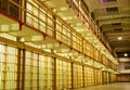 Prison cell block with cells on one side. Royalty Free Stock Photo