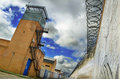 Prison and cloudy sky towerand concertina Stock Image
