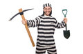 Prison inmate with axe and spade Royalty Free Stock Photo