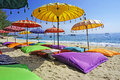 Pristine beach bathed by the bali sea this image shows some colourful umbrellas and sand pillows in a tropical Royalty Free Stock Images