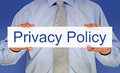 Privacy policy man in shirt and tie holding white sign with text on blue background Royalty Free Stock Photos