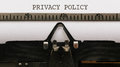 Privacy Policy, Text on paper in vintage type writer from 1920s Royalty Free Stock Photo