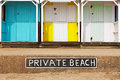 Private beach huts old wooden on a with sign Royalty Free Stock Photo