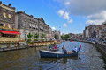 Private Boat Ride on Amsterdam Canal with Flag of the Netherlands Royalty Free Stock Photo