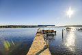 Private dock with jet ski lifts and covered boat lift, Lake Washington. Royalty Free Stock Photo
