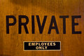 Private employees only a sign prominently displayed on a door Royalty Free Stock Image
