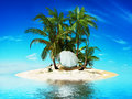 Private island paradise with palms and a beach umbrella Stock Photography
