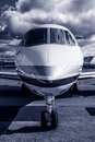 Private jet luxury corporate business plane at airfield toned in blue Royalty Free Stock Photo