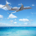 Private jet plane in flight Royalty Free Stock Image