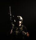 Private military contractor pmc with assault rifle on dark background Stock Image
