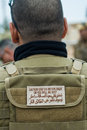 Private military contractor warning signal on a tactical vest owned a Stock Images