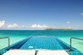 Private None edge swimming pool in the ocean Royalty Free Stock Photo