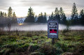 Private property no trespassing sign on a field Stock Photography