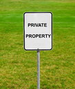 Private property sign on the green lawn Royalty Free Stock Photo