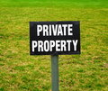 Private property sign on the green lawn Royalty Free Stock Image