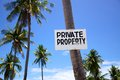Private Property sign on a palm tree Royalty Free Stock Images