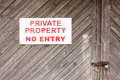 Private property sign a wooden gate with a no entry Stock Photos