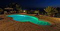 Private swimming pool at night Royalty Free Stock Photo