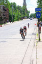 Pro cyclists at bottom of hill in stillwater minnesota usa june women approach downhill during final stage north star grand prix Stock Photography