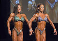 Pro figure winner from trinidad candice john of left poses with jennifer brown the usa th place in the contest of the ifbb Royalty Free Stock Photos