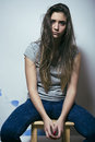 Problem depressioned teenage with messed hair and sad face indoor Stock Photo