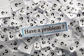Problem have a question marks on white papers hard light Stock Images