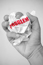 Problem solving concept symbolised with hand squashing a crumpled piece of paper Royalty Free Stock Image