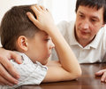 Problems in the family father comforts a sad child Stock Image