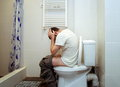 Problems in toilet man having Royalty Free Stock Photos