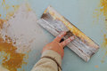 The process of applying the second layer of putty trowel for light plaster walls