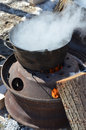 The process of boiling maple sap to create maple syrup using a traditional method Royalty Free Stock Photography