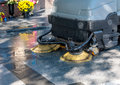 Process of cleaning walkways in the machine nature Royalty Free Stock Images