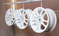 Process of powder coating auto wheels Royalty Free Stock Photo