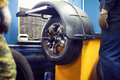 The process tire service, tyre wheel of car in motion, workers Royalty Free Stock Photo