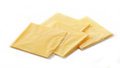 Processed cheese slices melted on white background Royalty Free Stock Images