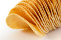 Processed chip stacked together on white Royalty Free Stock Photo