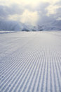 Processed snowcat track, stripes on snow Royalty Free Stock Photo