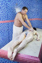 Processes facials male masseur makes women in the hammam Stock Images